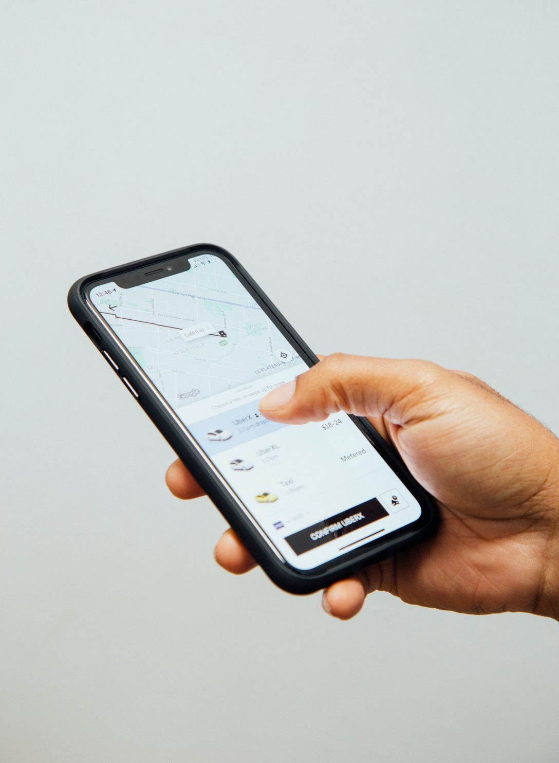 Someone holding a phone with the Uber App.