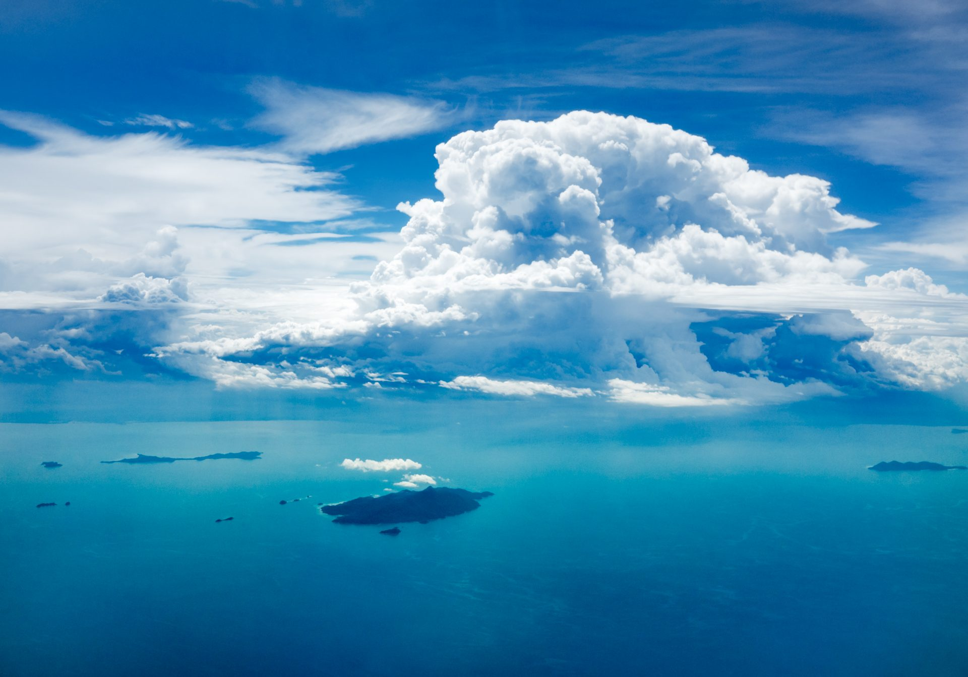 View of clouds and islands in the ocean