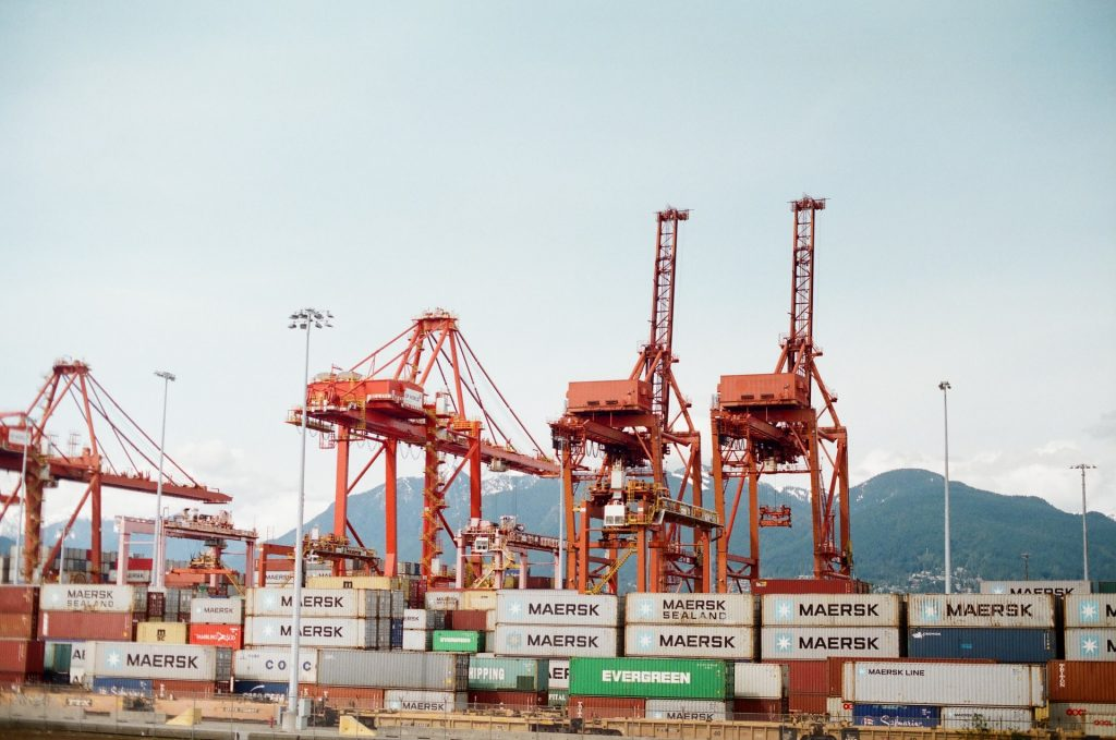 A series of containers and container cranes in Vancouver.